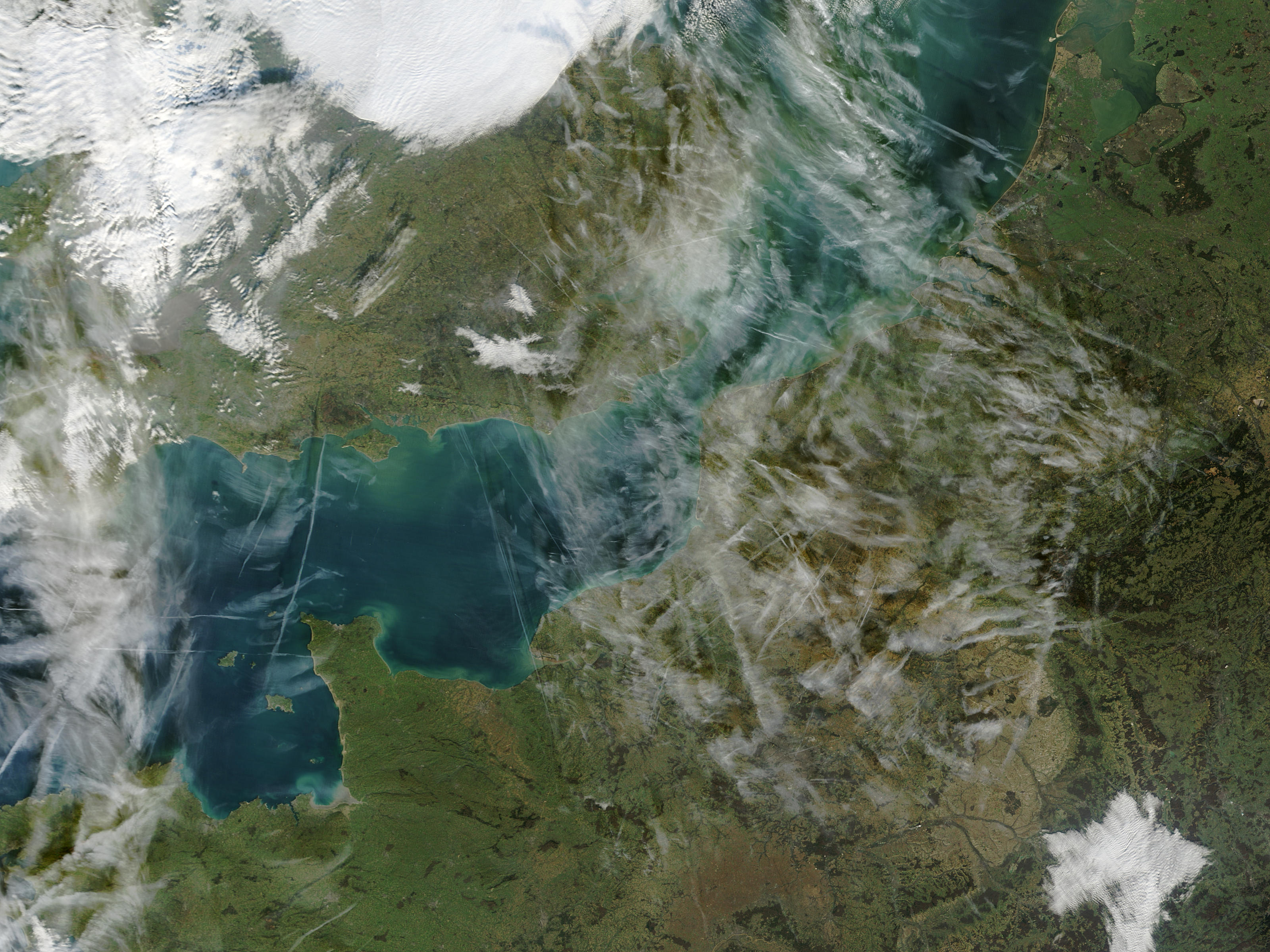 Airplane condensation trails (contrails) across the English Channel