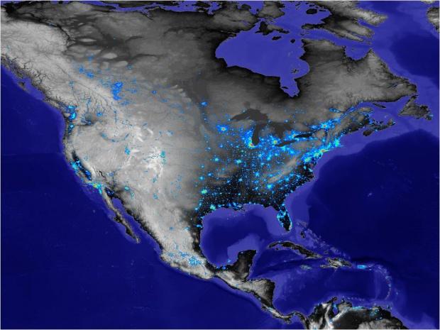 La iluminación por la noche de América del Norte